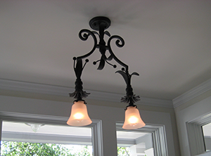 Custom created double pendant with embellishments and milk glass for Occidental, CA by customlightstyles